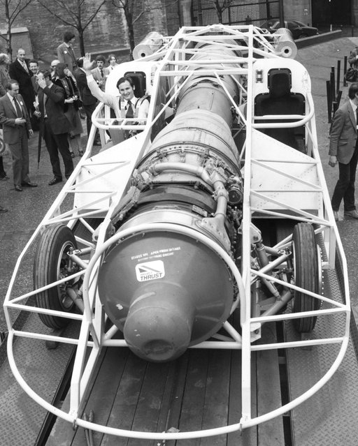 Driver and project leader Richard Noble at Tower Bridge, London, behind the wheel of the 60% complete jet car Thrust 2, in which he hopes to challenge the UK land speed record in the summer of 1980. The car is powered by a Rollys-Royce Avon jet engine, is 27 ft long, weighs 3 tons, has 2700 hp and can accelerate to 600 mph in 23 seconds, with a top speed of 650 mph. 6th December 1979 (Photo by Keystone)
