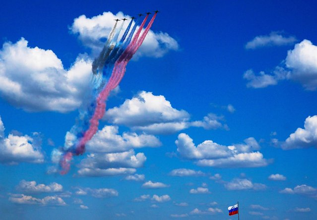 Russian Su-25 jet aircraft release smoke in the colors of the Russian state flag during the Victory Day Parade in Moscow, Russia, June 24, 2020. (Photo by Alexander Vilf/Host Photo Agency via Reuters)