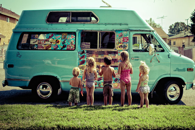 """""""Suburbia"""". Local kids getting treats from an ice cream truck that hails from the time we were that little, a generation ago. Photo location: Downey, California. (Photo and caption by Brian Callaway/National Geographic Photo Contest)"""