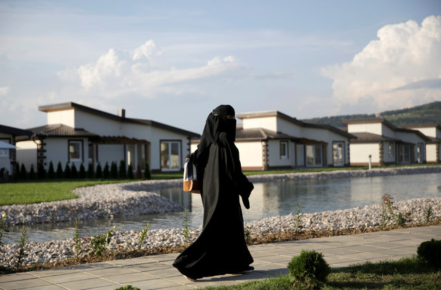 A tourist from the Middle East walks through Sarajevo Resort in Osenik near Sarajevo, Bosnia and Herzegovina, August 10, 2016. (Photo by Dado Ruvic/Reuters)