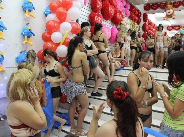 Customers in underwear queue to shop during a special promotion at a mall in Ciudad del Este, Paraguay, on December 2, 2012.   AFP PHOTO/ JOSE ESPINOLA        (Photo credit should read JOSE ESPINOLA/AFP/Getty Images)
