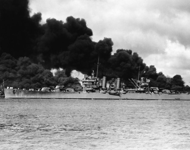 The American light cruiser USS Phoenix passing the burning USS West Virginia and USS Arizona, during the Japanese attack on Pearl Harbor, 7TH December 1941. (Photo by Hulton Archive/Getty Images)