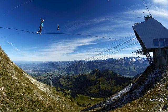 Competitors stand on lines during the Highline Extreme event in Moleson, Switzerland September 25, 2015. (Photo by Denis Balibouse/Reuters)