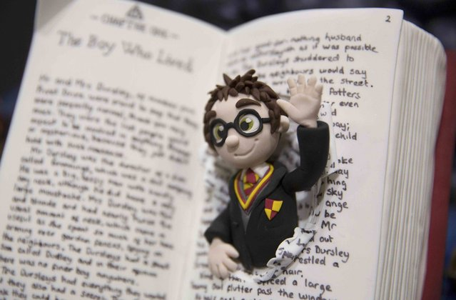 "A cake decorated as the children's book character ""Harry Potter"" is displayed at the Cake and Bake show in London, Britain October 3, 2015. (Photo by Neil Hall/Reuters)"