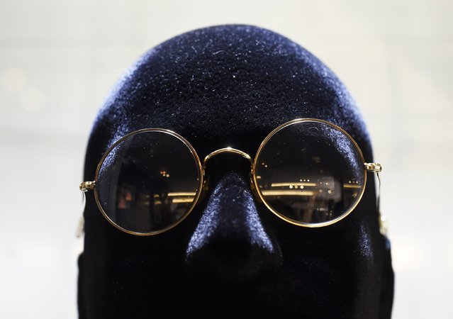 """Spectacles worn by John Lennon are pictured on display at Julien's Auctions for the upcoming """"Icons & Idols: Rock n Roll"""" auction in Beverly Hills, California November 3, 2014. The spectacles are expected to be auctioned off between $20,000 – $40,000. (Photo by Kevork Djansezian/Reuters)"""
