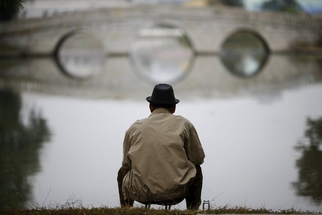 A man fishes in a pond in downtown Pyongyang, North Korea October 8, 2015. (Photo by Damir Sagolj/Reuters)