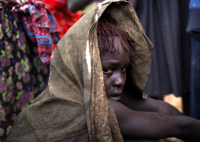 A Pokot girl cries after being circumcised in a village about 80 kilometres from the town of Marigat in Baringo County, October 16, 2014. (Photo by Siegfried Modola/Reuters)