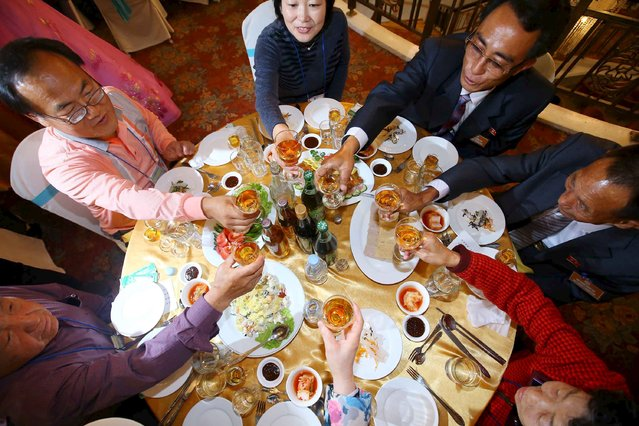 North and South Korean family members enjoy a group luncheon during the separated family reunions  at Mount Kumgang resort, North Korea, October 21, 2015. (Photo by Reuters/Yonhap)