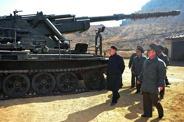 This undated picture released by North Korea's official Korean Central News Agency on March 12, 2013 shows North Korean leader Kim Jong Un (C) inspecting a long-range artillery sub-unit of Korean People's Army Unit 641 at undisclosed place in North Korea. (Photo by AFP  Photo/KCNA via KNS)
