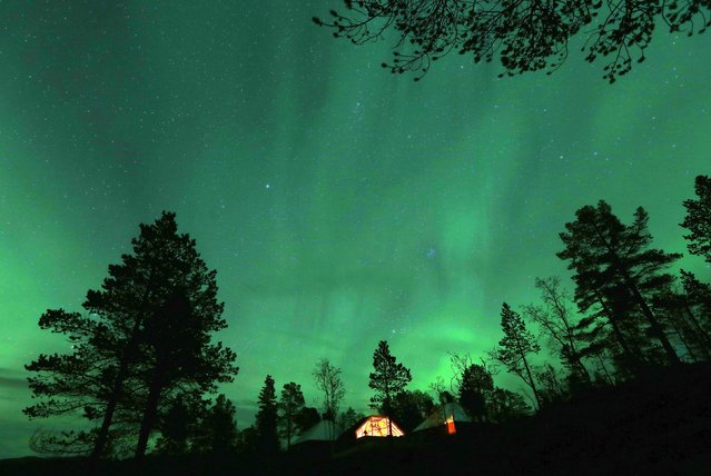 An Aurora Borealis (Northern Lights) is seen over a mountain camp north of the Arctic Circle, near the village of Mestervik, in this September 30, 2014 file photo. (Photo by Yannis Behrakis/Reuters)