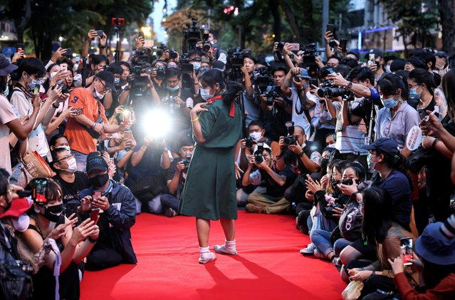 A protester performs on a red carpet while taking part in a protest against the government and to reform monarchy in Bangkok, Thailand, October 29, 2020. (Photo by Athit Perawongmetha/Reuters)