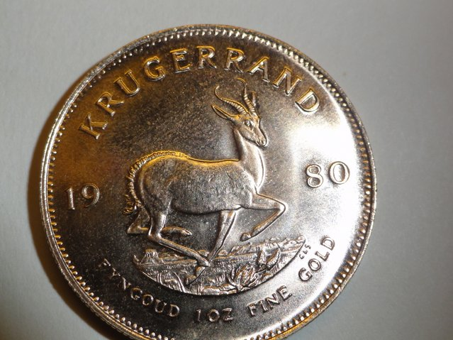 This photo released Tuesday, December 9, 2014, by the Salvation Army in Detroit, shows a 1980 South African gold Krugerrand, worth an estimated $1,200, that an anonymous donor recently dropped in a red kettle outside a Kroger store in the Detroit suburb of St. Clair Shores, Mich. Salvation Army spokeswoman Andrea Kenski said the coin is identical to one dropped at the same location one year ago. (Photo by Salvation Army/AP Photo)
