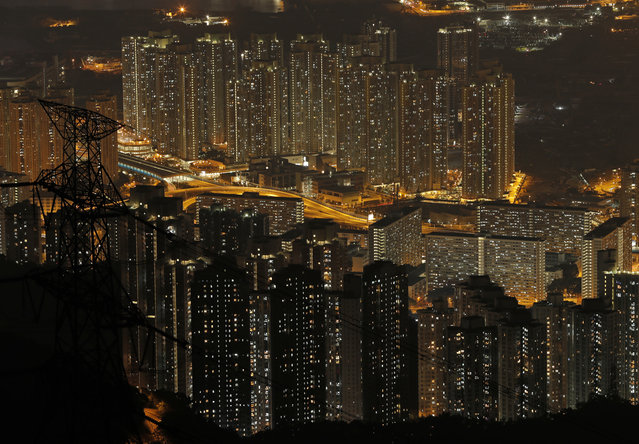 Tightly-packed buildings are seen from the Fei Ngo Shan in the night in Hong Kong, Saturday, April 1, 2017. (Photo by Vincent Yu/AP Photo)