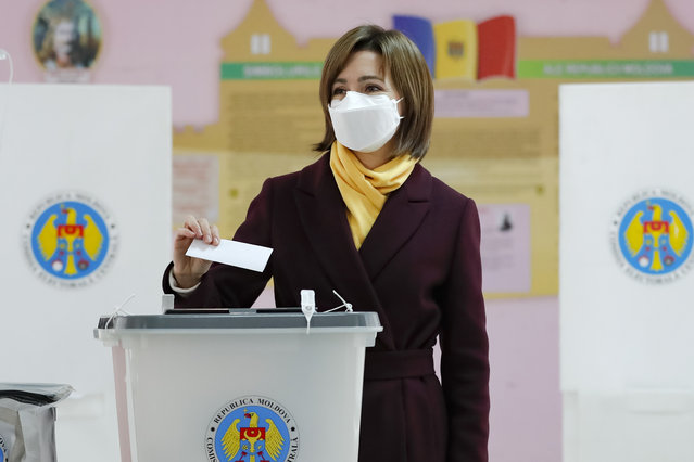 Former prime minister Maia Sandu prepares to cast her vote in the country's presidential election runoff in Chisinau, Moldova, Sunday, November 15, 2020. Moldovans returned to the polls Sunday for the second round of voting in the country's presidential election, facing a choice between the staunchly pro-Russian incumbent Igor Dodon, and his popular pro-Western challenger, former prime minister Maia Sandu. (Photo by Roveliu Buga/AP Photo)