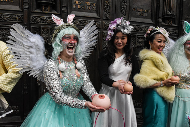 A woman wears an Easter bonnet while participating in the annual Easter parade along 5th Ave. on April 1, 2018 in New York City. Dating back to the 1870s the Easter parade attracts thousands of people each year. (Photo by Stephanie Keith/Getty Images)