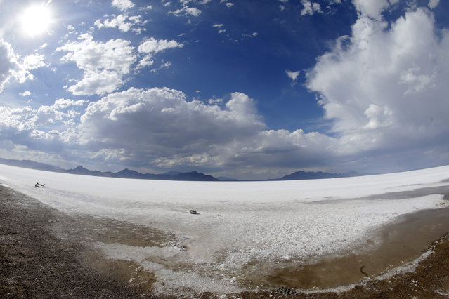 This Friday, July 17, 2015, photo taken with a wide angle lens, shows the Bonneville Salt Flats, in Utah. (Photo by Rick Bowmer/AP Photo)