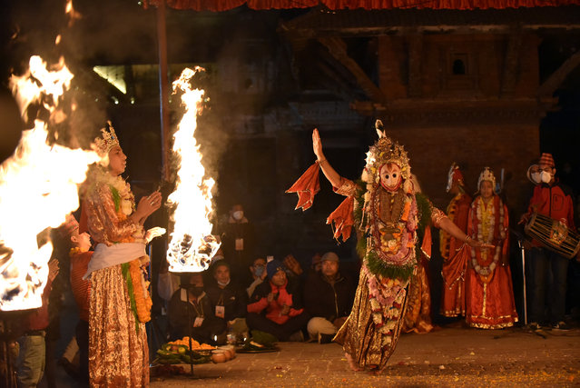 A Nepalese artist dressed as Lord Narsimha performs traditional dance during Kartik Naach festival at Patan Durbar Square, Lalitpur, Nepal on Sunday, November 29, 2020. Kartik Naach is a dance musical play is performed in Kartik Dabali, Patan Durbar Square every year. (Photo by Narayan Maharjan/NurPhoto via Getty Images)