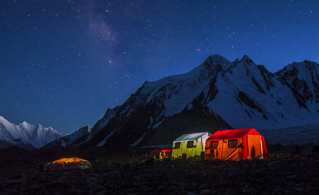 The porters' tent at K2's base camp is just a tarpaulin stretched over the stones, left, while the other tents belong to expedition members. (Photo by David Kaszlikowski/Rex Features)