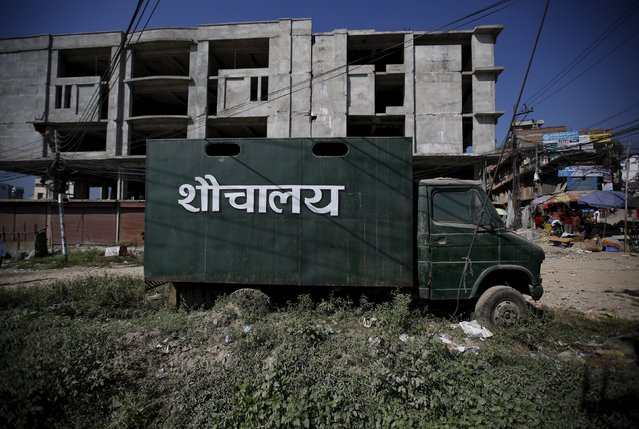 """A mobile toilet is parked on a road in Kathmandu, Nepal October 9, 2015. The word written on the vehicle reads """"toilet"""" in Nepalese. (Photo by Navesh Chitrakar/Reuters)"""