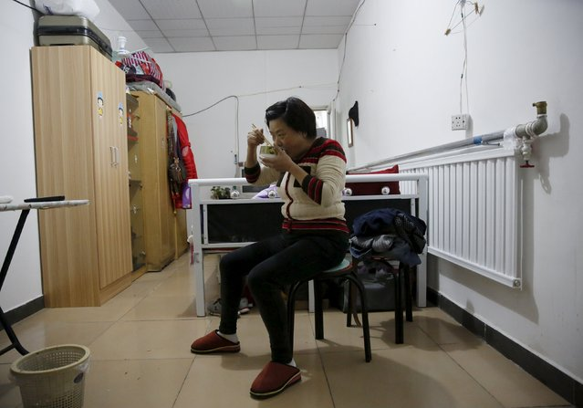 Migrant worker Lai Yongmei, 47, eats her breakfast as she prepares for her daily commute into Beijing, China, November 16, 2015. Yongmei commutes 90 minutes from her village home in the Shunyi district to the Sanlitun neighbourhood to clean corporate offices. Beijing, home to more than 21 million residents, is in the midst of launching itself into a mega-city where 110 million will live, served by new links to the port city of Tianjin and neighbouring Hebei province. (Photo by Kim Kyung-Hoon/Reuters)