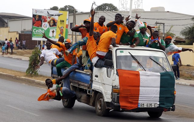 Fans of Ivory Coast cheer from a vehicle ahead of their Group D soccer match against Guinea in the African Cup of Nations in Malabo January 20, 2015. (Photo by Amr Abdallah Dalsh/Reuters)