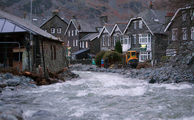 Fast-flowing water runs through Glenridding after yet more heavy rainfall in Cumbria, England on December 10, 2015. (Photo by Danny Lawson/PA Wire)