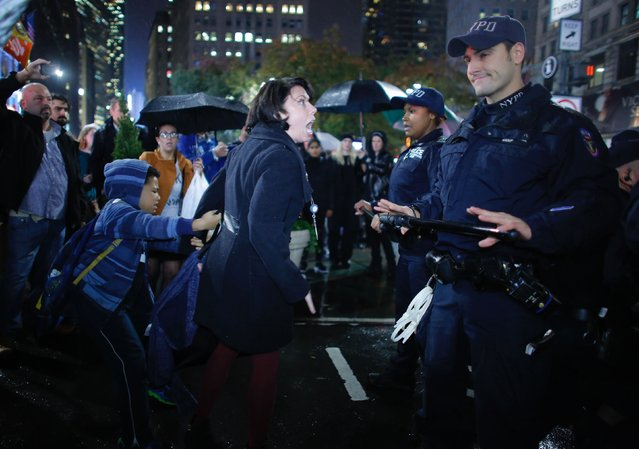 A woman argues with NYPD officers as she takes part in a protest against President-elect Donald Trump in New York City on November 9, 2016. (Photo by Kena Betancur/AFP Photo)