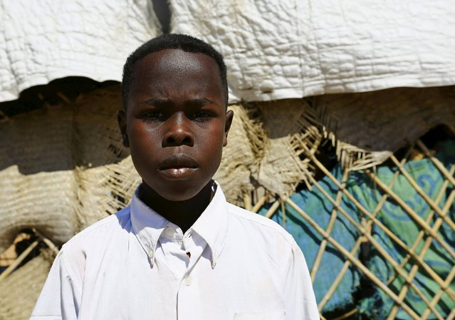Mazin Hassan Mohamed poses for a photograph in Kalma camp in Nyala, South Darfur, Sudan, November 22, 2015. Born in the camp, 12-year-old Mohamed wishes to be a manger of his on company in his adulthood. (Photo by Mohamed Nureldin Abdallah/Reuters)