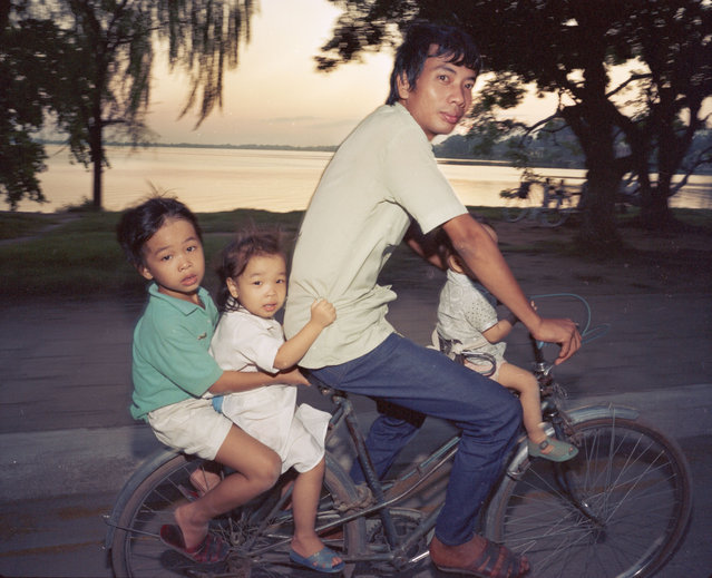 "Bicycles  – going home, 1987. (Photo by  William E. Crawford from the book ""Hanoi Streets 1985-2015: In the Years of Forgetting"")"