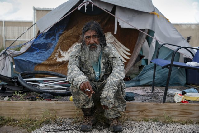 "Daniel J. Wabsey, a 58-year-old war veteran, sits outside his tent at Camp Hope in Las Cruces, New Mexico October 6, 2015. ""I've been traveling for 35 or 38 years. Getting inside would take a while to get used to. I just want to be able to eat, sleep and be safe. We all get along and understand in Camp Hope. We've all been there. With common sense you can survive out here"", Wabsey said. Camp Hope describe themselves as an ""alternative transitional living project for the homeless"". Around 50 people live at the camp. (Photo by Shannon Stapleton/Reuters)"