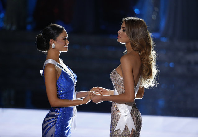 Miss Colombia Ariadna Gutierrez, right, and Miss Philippines Pia Alonzo Wurtzbach wait for the announcer to name the new Miss Universe at the Miss Universe pageant on Sunday, December 20, 2015, in Las Vegas. Gutierrez was incorrectly crowned before Wurtzbach was named Miss Universe. (Photo by John Locher/AP Photo)