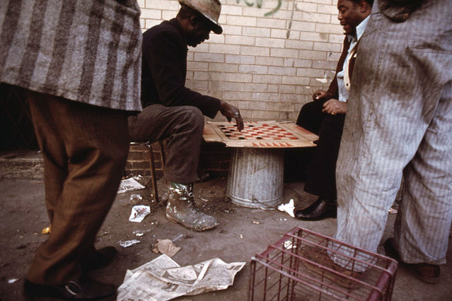 Workers pass the time playing checkers on East 35th Street before going to work in Chicago, May 1973. (Photo by John H. White/NARA via The Atlantic)