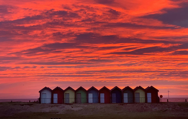 Colourful beach huts stand in front of the stunning red sky at sunrise in Blyth, Northumberland onTuesday February 23, 2021. (Photo by Owen Humphreys/PA Images via Getty Images)