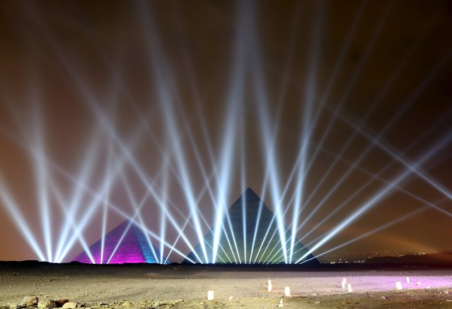 Pyramids are illuminated during New Year's day celebrations on the outskirts of Cairo, Egypt, January 1, 2016. (Photo by Mohamed Abd El Ghany/Reuters)