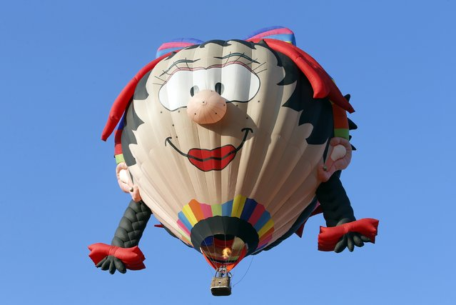 The Miss Daisy hot air balloon flies during the Philippine International Hot Air Balloon Fiesta at Clark Freeport Zone in Pampanga province, north of Manila February 12, 2015. (Photo by Erik De Castro/Reuters)