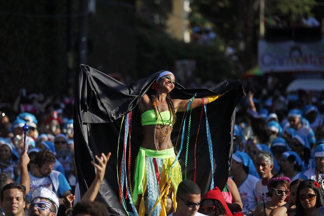 """Revellers take part in an annual block party known as """"Carmelitas"""", which is one of the many carnival parties to take place in the neighbourhoods of Rio de Janeiro February 13, 2015. (Photo by Pilar Olivares/Reuters)"""