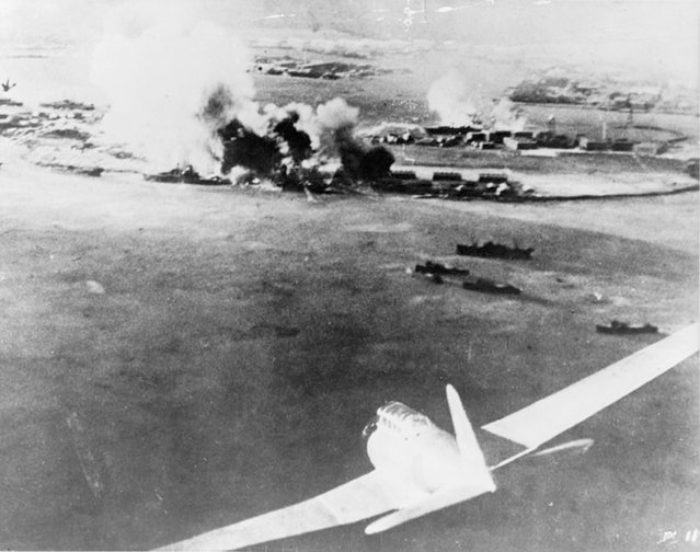 A Japanese bomber aircraft is seen in the foreground of an aerial photograph taken by a Japanese pilot during the attack on Pearl Harbor, Hawaii, U.S. December 7, 1941. (Photo by Reuters/U.S. Navy/NEA Services)