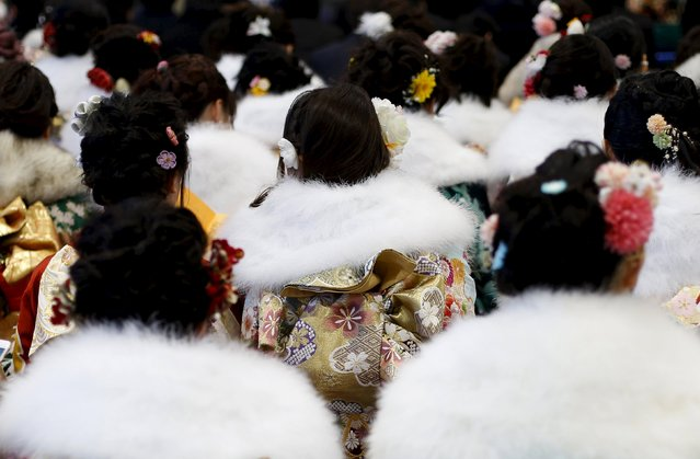 Japanese women wearing kimonos attend a Coming of Age Day celebration ceremony at an amusement park in Tokyo January 11, 2016. (Photo by Yuya Shino/Reuters)