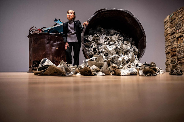 """Japanese artist Kimiyo Mishima poses with her """"Work 21-A"""" during a media preview of """"Another Energy: Power to Continue Challenging – 16 Women Artists from around the World"""" at Mori Art Museum in Tokyo on April 21, 2021. (Photo by Philip Fong/AFP Photo)"""