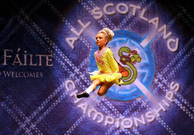 Sarah McDaid from Ireland performs in front of judges in  one of the heats in the All Scotland Championships in Irish Dancing being held at the Royal Concert Hall in Glasgow. Almost 2,000 competitors are taking part  in Glasgow for one of the world's biggest Irish dancing competitions. The dancers represent some 300 dance schools from across the world, from as far afield as North America, South Africa, Australia and Russia. (Photo by Andrew Milligan/PA Wire)