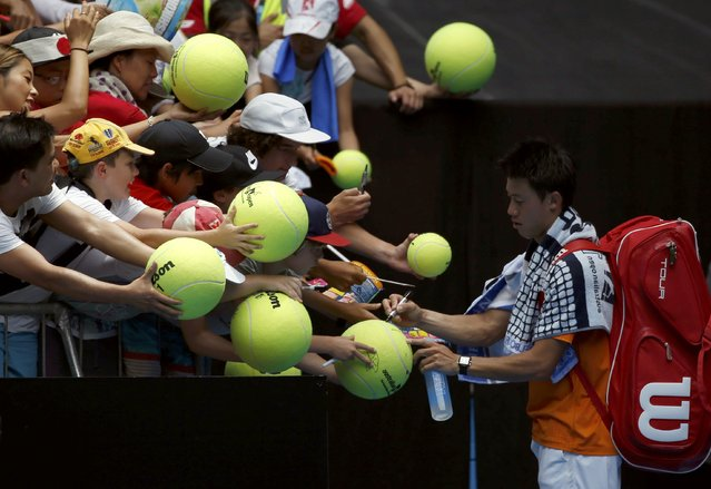 Japan's Kei Nishikori signs autographs after winning his first round match against Germany's Philipp Kohlschreiber at the Australian Open tennis tournament at Melbourne Park, Australia, January 18, 2016. (Photo by Issei Kato/Reuters)
