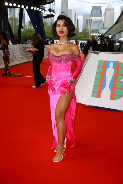 In a handout picture released by the Brit Awards British singer-songwriter Raye poses on the red carpet on arrival for the BRIT Awards 2021 in London on May 11, 2021. (Photo by John Marshall/Handout via Reuters)