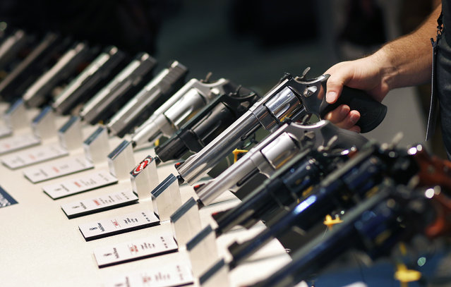 Handguns are on display at the Smith & Wesson booth at the Shooting, Hunting and Outdoor Trade Show, Tuesday, January 19, 2016, in Las Vegas. (Photo by John Locher/AP Photo)