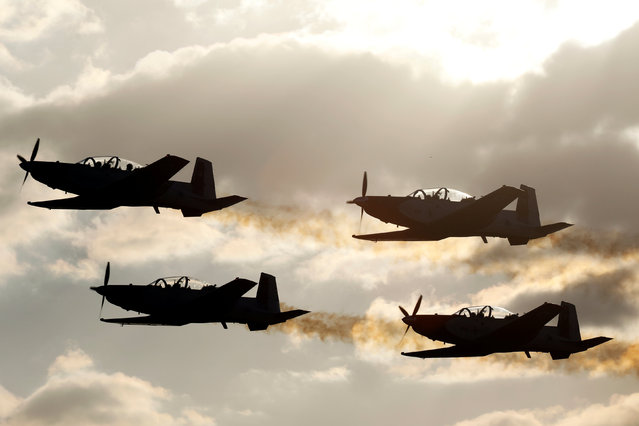 Israeli Air Force T-6 Texan II planes fly in formation during an aerial demonstration at a graduation ceremony for Israeli air force pilots at the Hatzerim air base in southern Israel December 29, 2016. (Photo by Amir Cohen/Reuters)