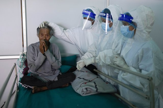 Frontline health workers bid farewell to visually impaired 74 years old Kaile Tamang after recovering from COVID-19 at Radha Soami COVID Isolation & Oxygen Therapy Center in Kathmandu, Nepal on Friday, June 25, 2021. (Photo by Skanda Gautam/ZUMA Wire/Rex Features/Shutterstock)