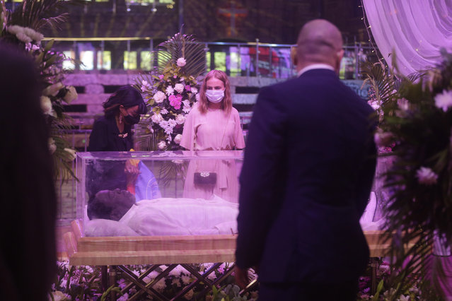 Mourners pay their last respects to Televangelist Temitope Balogun Joshua, during a Lying in state service at in Lagos, Nigeria, Thursday July 8, 2021. Thousands of Nigerians paid their last respects to Temitope Balogun Joshua, one of Africa's most popular televangelists, known as T.B. Joshua. The controversial Nigerian-born pastor died about a month ago at the age of 57. A memorial service was held for him Thursday at the auditorium of the Lagos headquarters of the megachurch he founded, Synagogue Church Of All Nations. (Photo by Sunday Alamba/AP Photos)