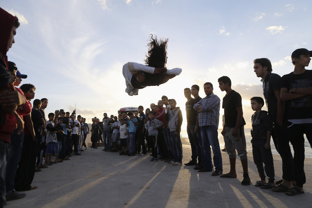 Young Libyans practise parkour on the beach in Benghazi November 22, 2013. (Photo by Esam Omran/Reuters)