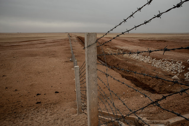 A barbed wire fence mark the limits of the Zurihe military training camp. Local herders have been expropriated without proper compensation for the creation of the base. (Photo by Gilles Sabrie/The Washington Post)