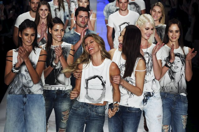 Model Gisele Bundchen is embraced and applauded as she presents a creation from the Colcci Summer 2016 collection during Sao Paulo Fashion Week in Sao Paulo April 15, 2015. (Photo by Paulo Whitaker/Reuters)