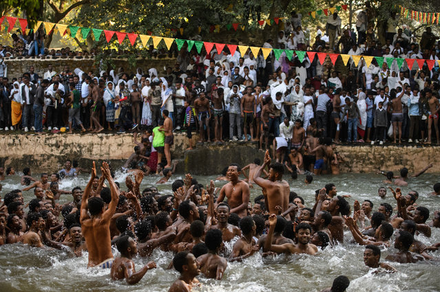 Ethiopian Orthodox worshippers swim in Fasilides Bath during the annual Timkat epiphany celebration on January 19, 2017 in Gondar, Ethiopia. (Photo by Carl Court/Getty Images)